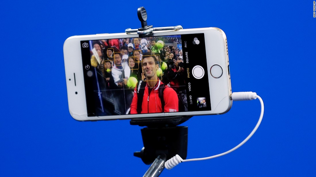 Novak Djokovic, the world's top-ranked tennis player, takes a selfie with spectators in Beijing after a win at the China Open on Friday, October 9.