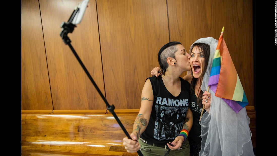 "Natalie Novoa, left, and Eddie Daniels take a selfie while waiting to get married in Los Angeles County on Friday, June 26. Earlier in the day, the U.S. Supreme Court ruled that <a href=""http://www.cnn.com/2015/06/26/politics/gallery/supreme-court-same-sex-marriage-ruling-photos/index.html"" target=""_blank"">same-sex couples have a constitutional right to marry</a> in all 50 states."