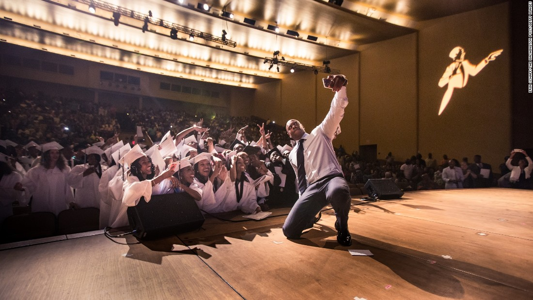 Comedian Dave Chappelle takes a selfie with seniors from the Duke Ellington School of the Arts at their graduation ceremony Sunday, June 14, in Washington. Chappelle gave the commencement address at the high school, which he once attended.