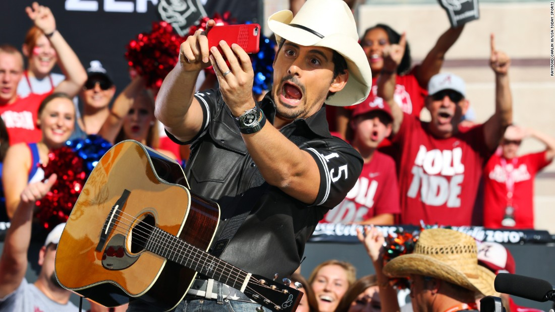 "Country singer Brad Paisley makes a funny face while performing live on the set of ESPN's ""College GameDay"" on Saturday, September 5."