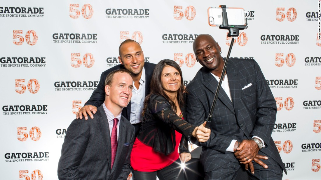 From left, sports icons Peyton Manning, Derek Jeter, Mia Hamm and Michael Jordan take a selfie together at Gatorade's 50th anniversary celebration on Saturday, January 31.