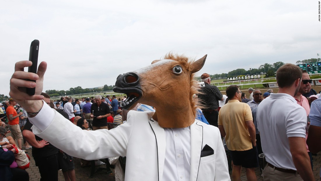 "A spectator wearing a horse mask takes a selfie Saturday, June 6, before the Belmont Stakes in Elmont, New York. <a href=""http://www.cnn.com/2015/06/01/sport/gallery/american-pharoah/index.html"" target=""_blank"">American Pharoah</a> won the race and became <a href=""http://www.cnn.com/2012/06/07/worldsport/gallery/triple-crown-winners/index.html"" target=""_blank"">the first horse since 1978</a> to win the Triple Crown."