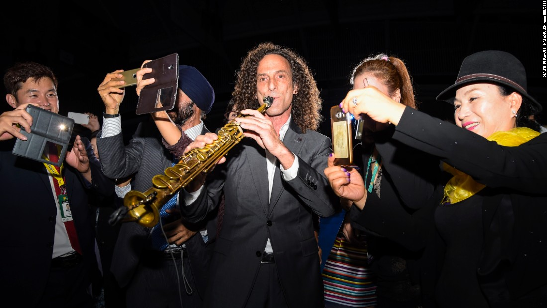 People in Incheon, South Korea, take selfies with recording artist Kenny G during the opening ceremony of the Presidents Cup golf tournament on Wednesday, October 7.