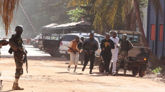 Security forces help people flee the hotel on November 20.