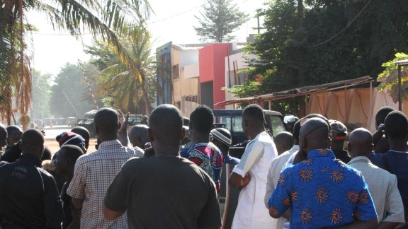 Onlookers gather near the hotel on November 20.