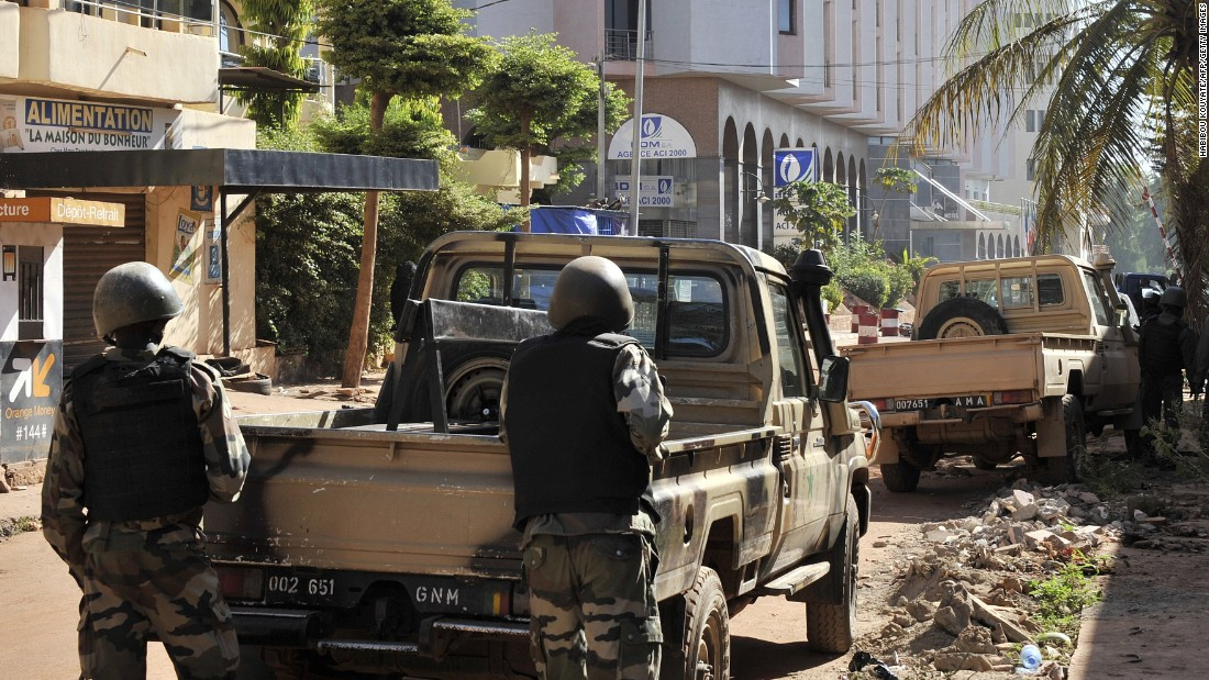 Malian troops are seen outside the hotel on November 20.