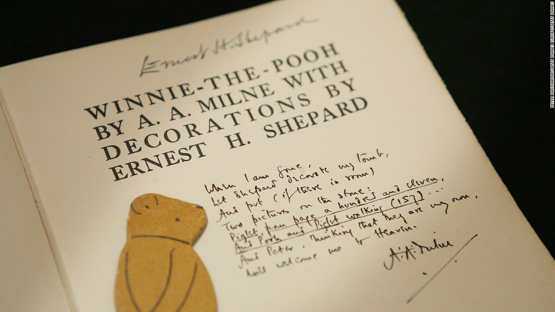 "An early edition ""Winnie-the-Pooh"" book showing an inscription from author AA Milne asking for artist EH Shepard to decorate his tomb, is displayed at a press preview at Sotheby's Auctioneers in 2008."