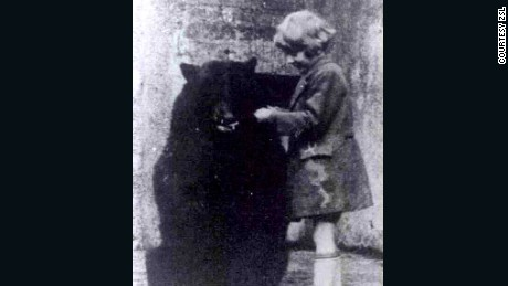 "Author A.A. Milne's son, Christopher Robin, pictured here with the original black bear who inspired ""Winnie-the-Pooh."""