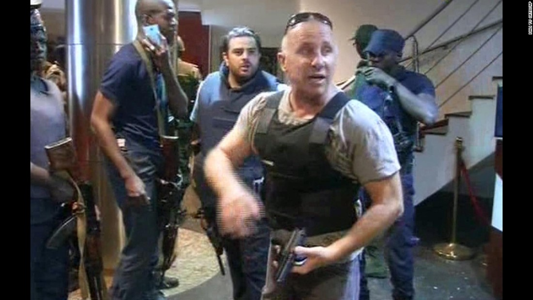 In this screengrab from the country's state broadcaster, ORTM, an officer gives instructions to security forces inside the hotel on November 20.