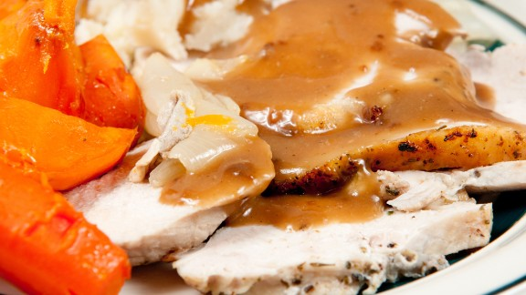 The centerpiece of most Thanksgiving dinners, a 3-ounce serving of roasted white meat turkey has 125 calories. You bring up the calorie count by opting for dark meat instead of light —it has 147 calories -- and eating the skin, which adds 26 calories.