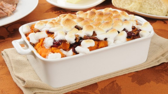 A one-cup serving of sweet potato casserole can have a whopping 460 calories. Did you really expect anything less from a marshmallow-topped dessert that masquerades as a side dish? You can halve the calories by substituting a pecan topping for the marshmallows and mixing fruit juice and honey instead of butter and sugar into the sweet potatoes.