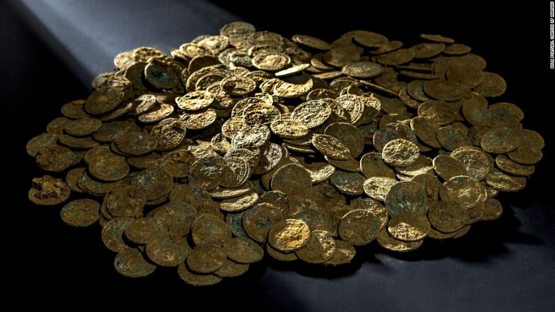 A Swiss farmer discovered the coins in his cherry orchard, after seeing a shimmering object.