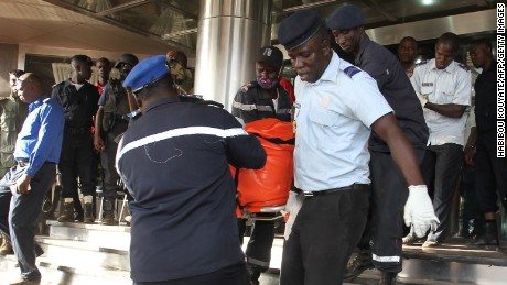 "Officers evacuate bodies of victims from the Radisson Blu hotel in Bamako on November 20, 2015, after the assault of security forces. Malian forces backed by French troops stormed the Radisson Blu hotel in the capital Bamako after suspected Islamist gunmen seized guests and staff in a nine-hour hostage crisis that left at least 18 people dead. UN Secretary-General Ban Ki-moon condemned the ""horrific terrorist attack"" on November 20, and indicated the violence was aimed at destroying peace efforts in the country. AFP PHOTO / HABIBOU KOUYATE        (Photo credit should read HABIBOU KOUYATE/AFP/Getty Images)"