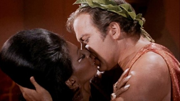 Nichelle Nichols and William Shatner embrace in what is widely credited as America's first interracial kiss on TV.