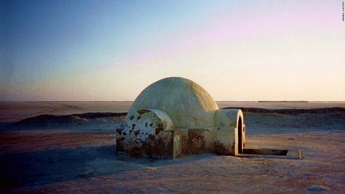 "The films famously shot scenes for Tatooine in Tunisia, utilizing grain storage containers called ghorfas and turning the Sisi el Driss Hotel in Matmata into Luke's subterranean home. Pictured is the entrance to Luke's homestead, which <a href=""http://edition.cnn.com/blogarchive/insidethemiddleeast.blogs.cnn.com/2012/07/12/star-wars-fans-restore-luke-skywalkers-tunisia-ranch/"">fans restored in 2012</a>."