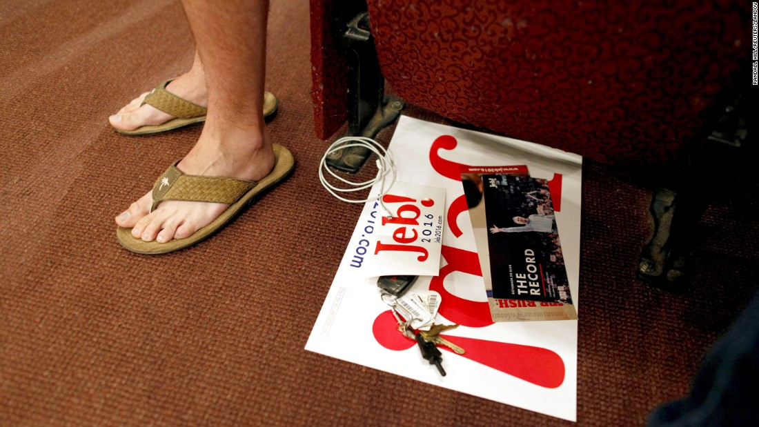 A college student wears flip-flops in the front row as he watches Republican presidential candidate Jeb Bush speak at a town-hall meeting in Conway, South Carolina, on Tuesday, November 17.