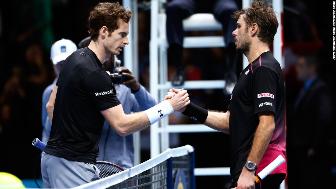 Stan Wawrinka, right, clinched second in the group after beating Andy Murray 7-6 (7-4) 6-4. Wawrinka now faces Roger Federer in a repeat of last year's semi won by Federer in three dramatic sets.