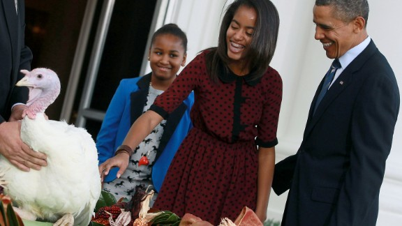 Malia Obama pets Liberty the turkey in 2011.