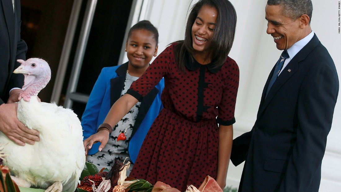 Obama is flanked by his Sasha and Malia after pardoning Liberty, a 45-pound turkey, at the North Portico of the White House on November 23, 2011.