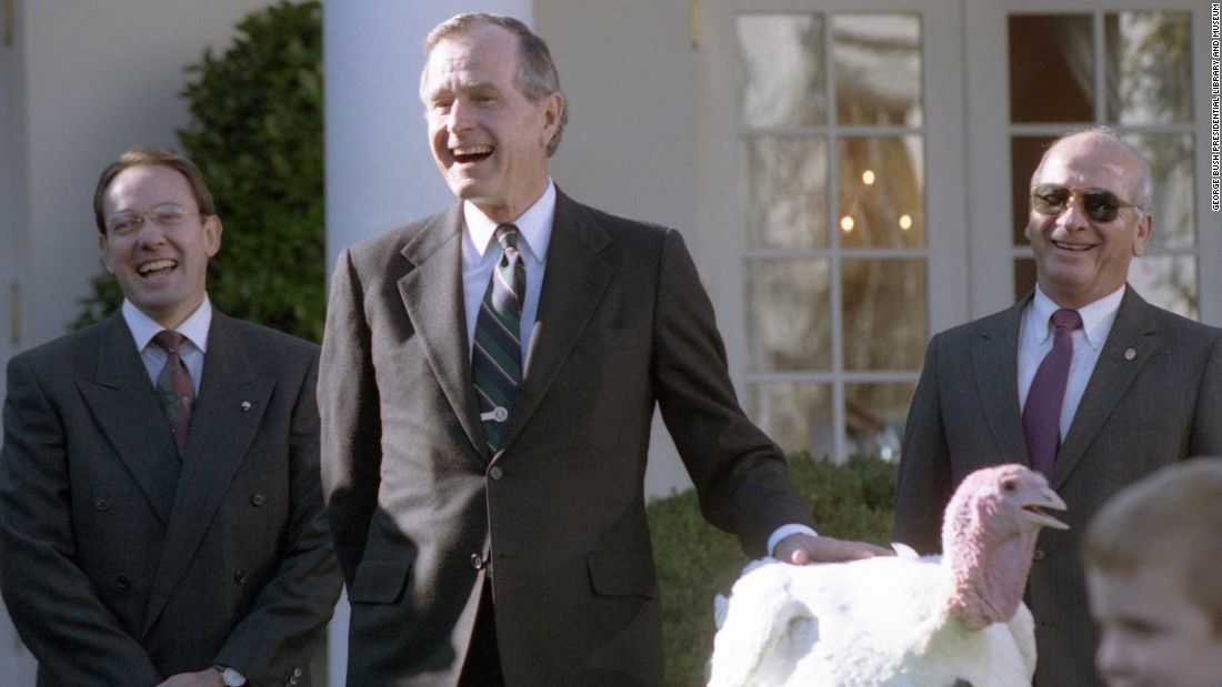 President George H.W. Bush participates in the presentation and pardoning of the national Thanksgiving turkey in the Rose Garden in 1990.