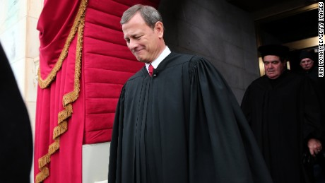 Supreme Court Chief Justice John Roberts arrives during the presidential inauguration on the West Front of the US Capitol January 21, 2013 in Washington, DC