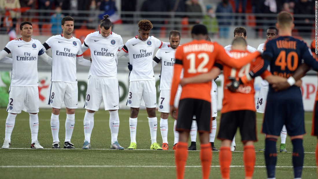 Players of PSG and Lorient observe a minute of silence in tribute to victims of Paris terror attacks.