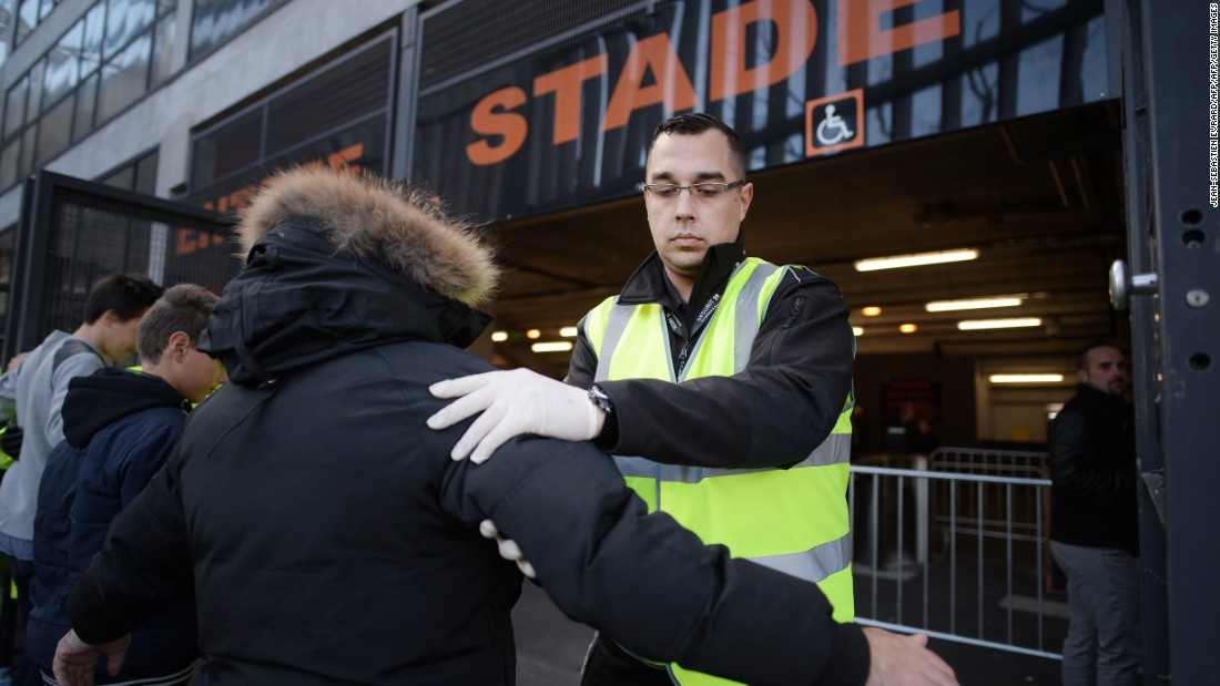 A security guard searches people outside the Moustoir stadium in Lorient.