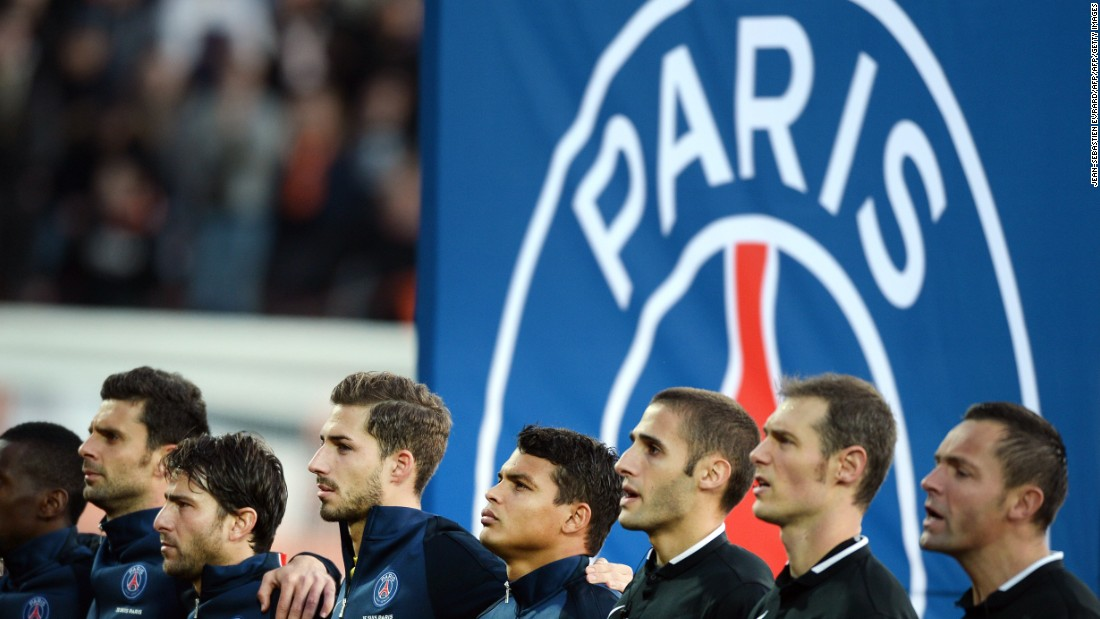 PSG players and referees sing the French national anthem La Marseillaise prior kick-off.