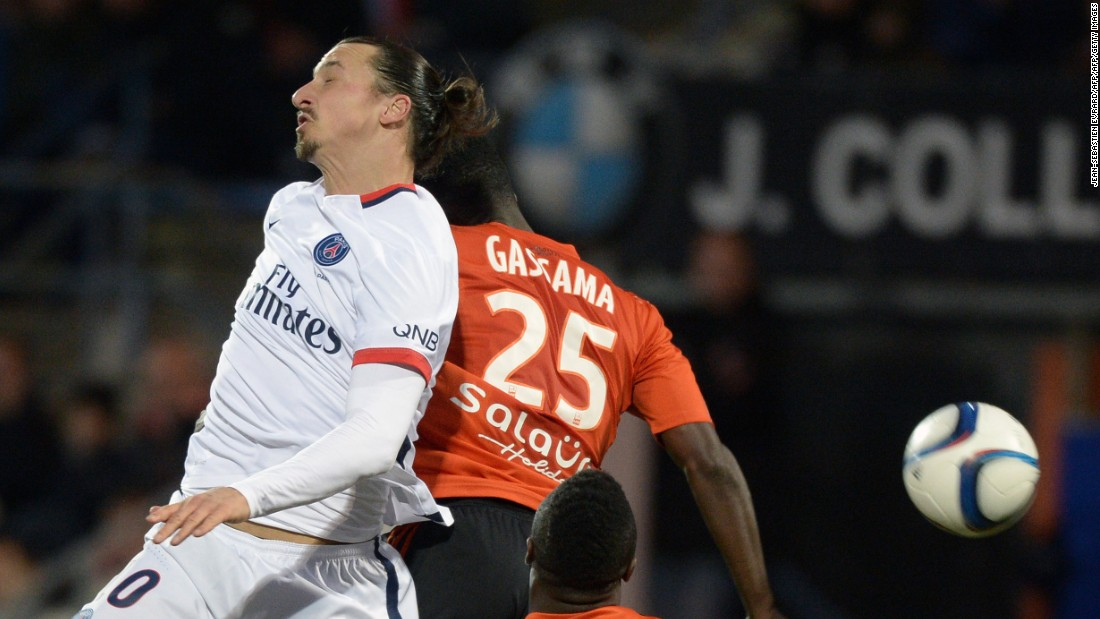 PSG's Swedish forward Zlatan Ibrahimovic (L) vies with Lorient's French Senegalese defender Lamine Gassama during the match.
