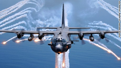 An AC-130H gunship from the 16th Special Operations Squadron, Hurlburt Field, Fla., jettisons flares as an infrared countermeasure during multi-gunship formation egress training on Aug. 24, 2007. (U.S. Air Force photo by Senior Airman Julianne Showalter) (RELEASED)