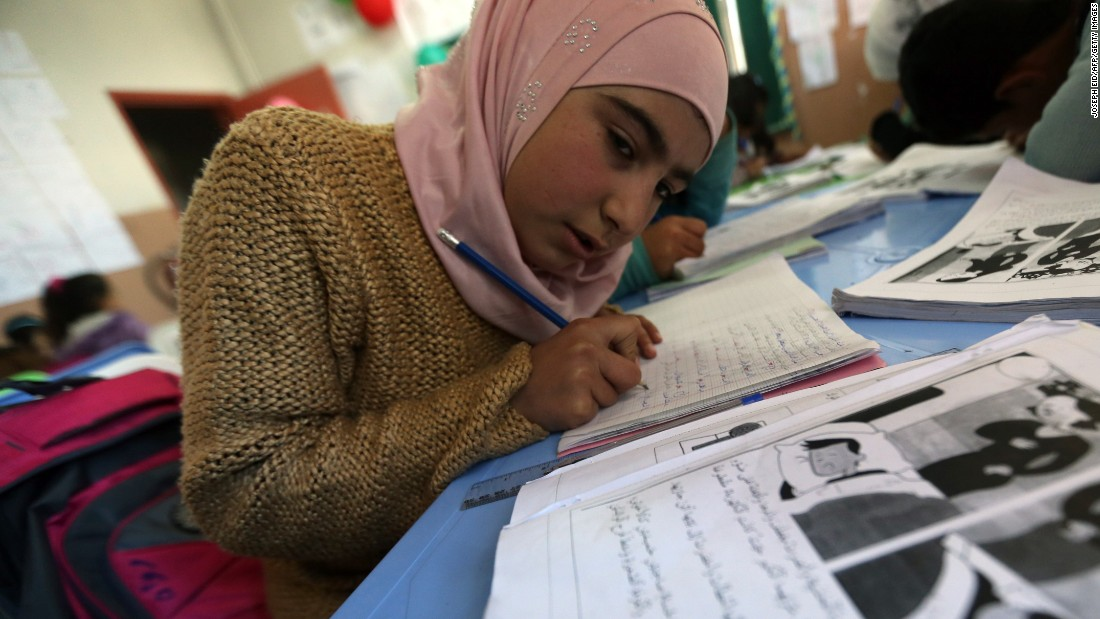 A contribution to the International Rescue Committee could help Syrian refugees, like these children studying at an IRC school in Lebanon, and others who have fled their war-torn homes around the world.