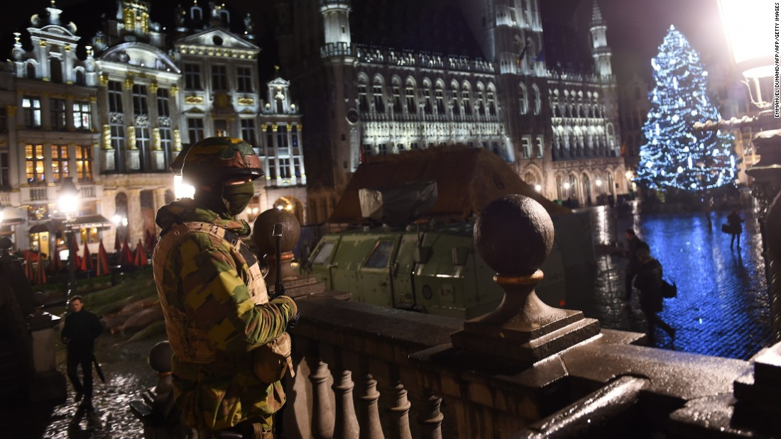 A Belgian soldier stands guard around a security perimeter as a reported police intervention takes place around the Grand Place central square in Brussels on Sunday, November 22.  Multiple raids took place throughout Brussels, according to the Belgium Federal prosecutor, and 16 people were arrested. Salah Abdeslam, a suspect in Paris terror attacks, was not among them.