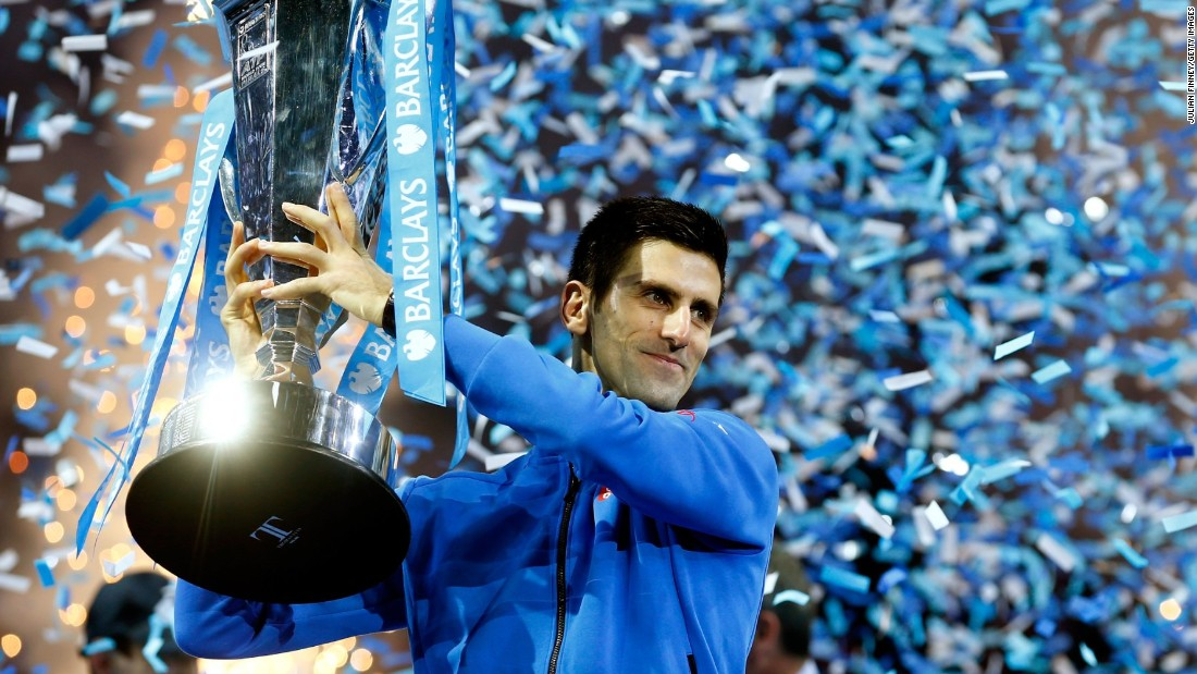 Novak Djokovic of Serbia lifts the trophy after beating Switzerland's Roger Federer of Switzerland in the final of the ATP World Tour Finals.