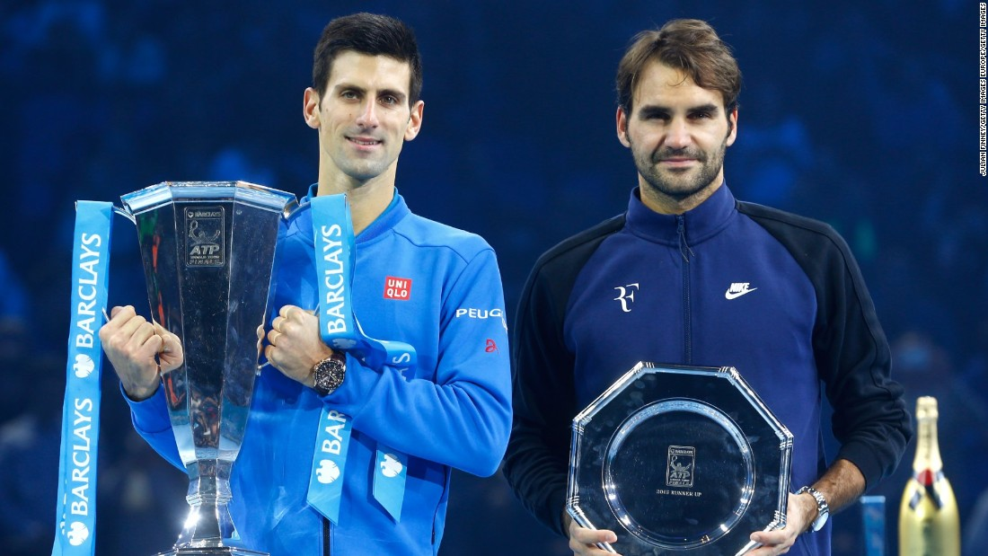 Djokovic and runner up Federer of Switzerland pose with their trophies following the final at the O2 Arena.