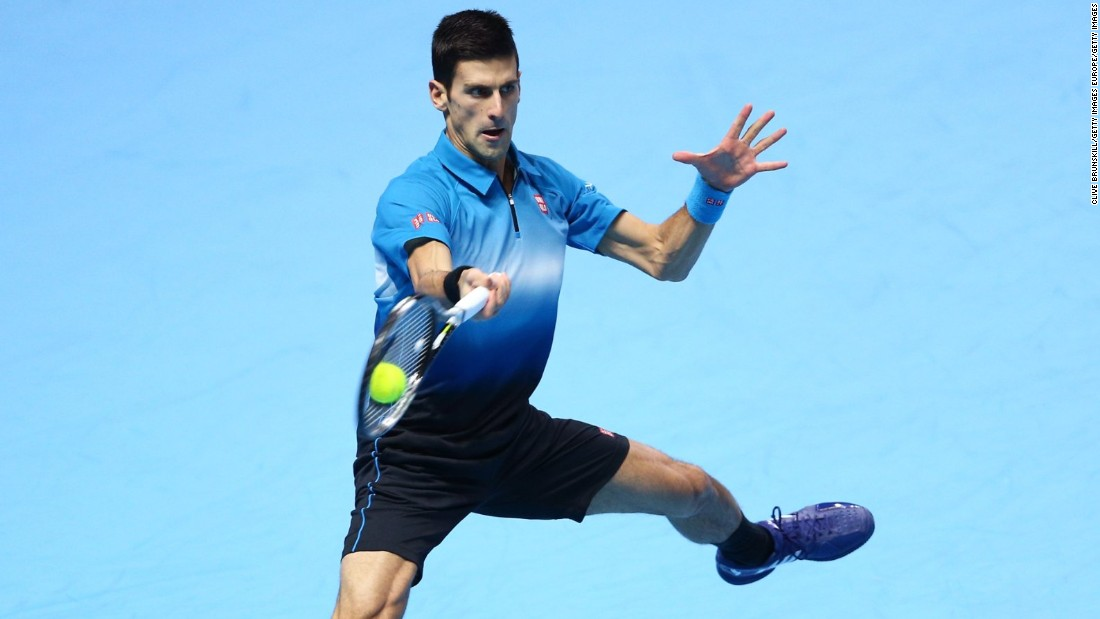 Djokovic pounds a forehand as he takes control against Federer in a largely one-sided final.