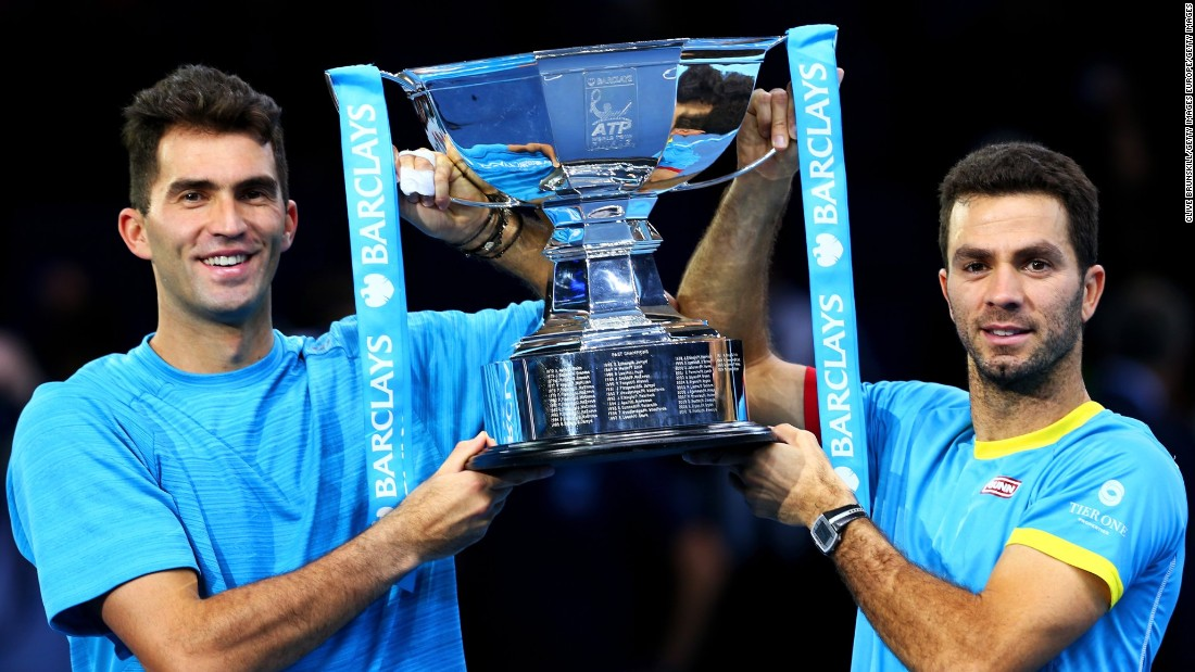 Horia Tecau of Romania and Jean-Julien Rojer of France lift the trophy after claiming the doubles title at the ATP World Tour finals, beating Rohan Bopanna of India and Florin Mergea of Romania in the final.