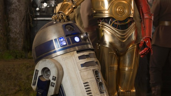 "Poor old Threepio looks like a third-hand car with a door of a different color. Sloppy repair work or outlandish style choice? Whatever the case, J.J. Abrams has confirmed that the red arm comes from the desire to ""mark time,"" using a familiar character to signal the 30-year lapse since the end of ""Return of the Jedi."" We hear that the full story of C-3PO's limb replacement will be told in a comic book."