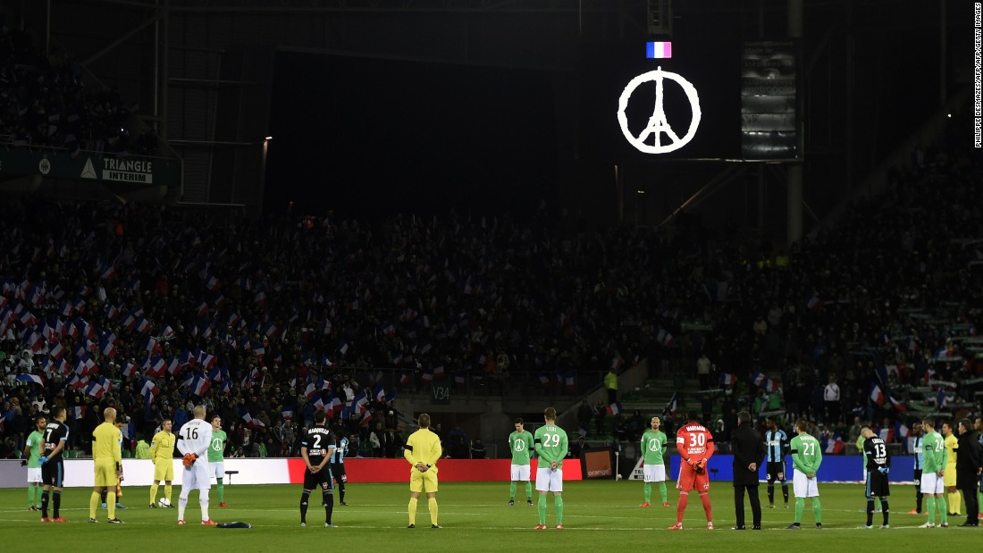 "Saint-Etienne and Marseille players and fans held a minute's silence before their Ligue 1 football match Sunday. Paris' Eiffel Tower and the symbol of peace has been adopted as a <a href=""http://edition.cnn.com/2015/11/15/design/peace-for-paris/"">unifying response</a> to the terror attacks on the city -- in which 130 people were killed. St Etienne's shirt incorporated the image for the game against Marseille."
