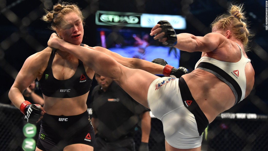 Holly Holm delivers a knockout kick to Ronda Rousey during their UFC title fight Sunday, November 15, in Melbourne. Holm finished the heavily favored Rousey in the second round. It was the first defeat of Rousey's career.