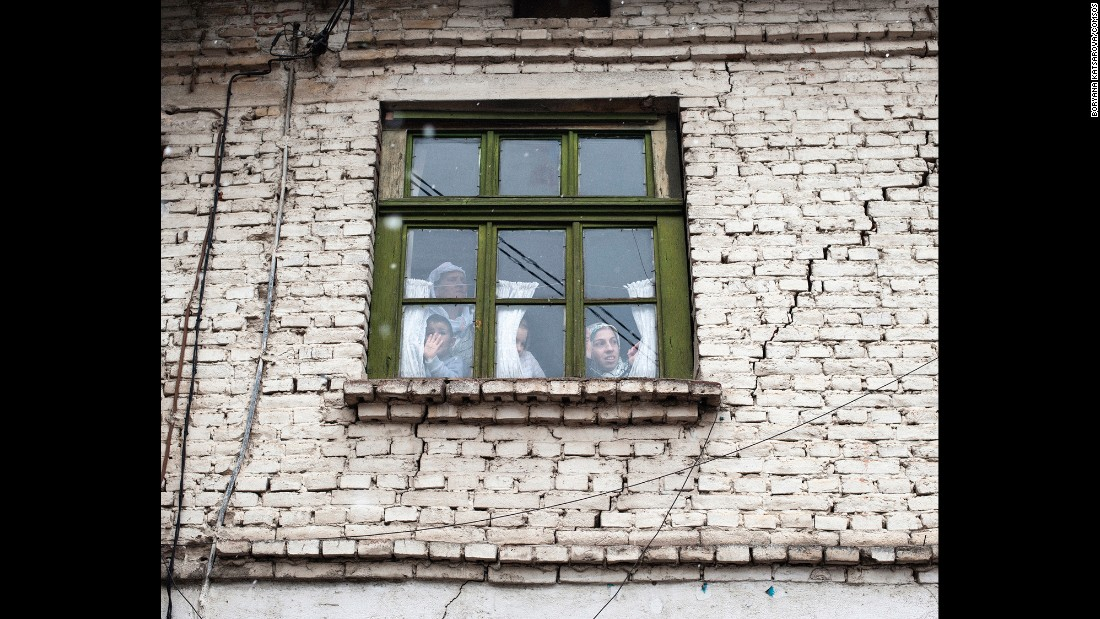 Ribnovo residents look through a window on the first day of the wedding ceremony.