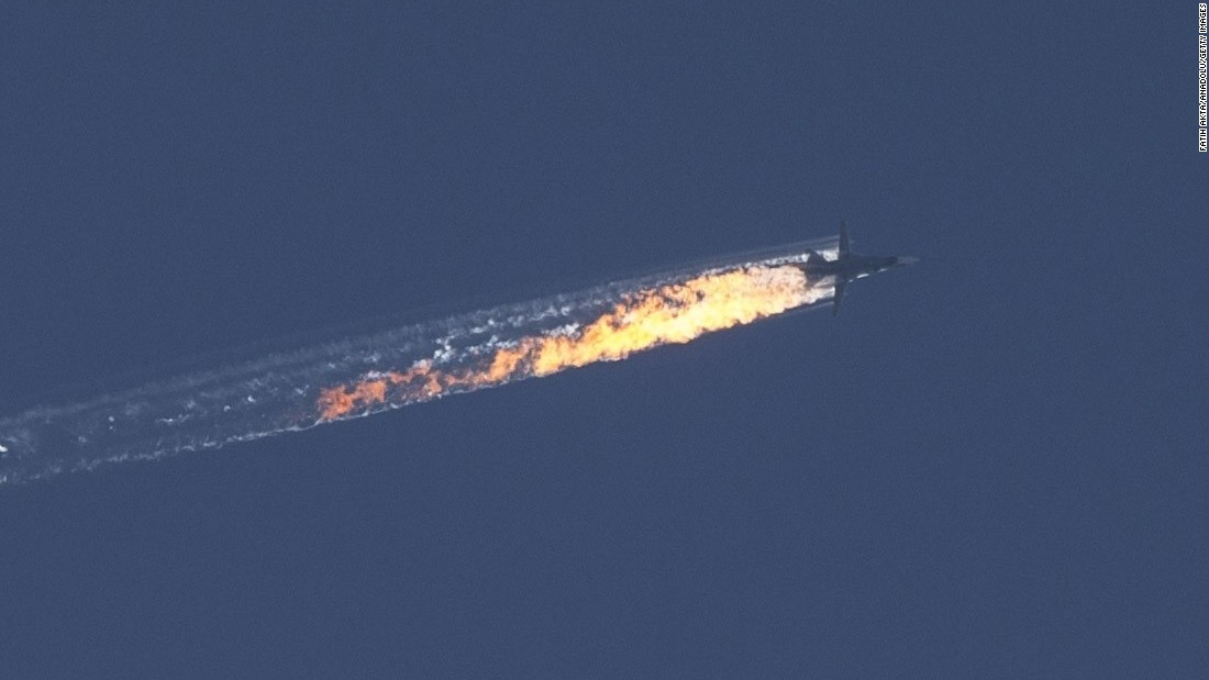 A Russian warplane goes down in Syria's Bayirbucak region, near the Turkish border, on November 24, 2015.