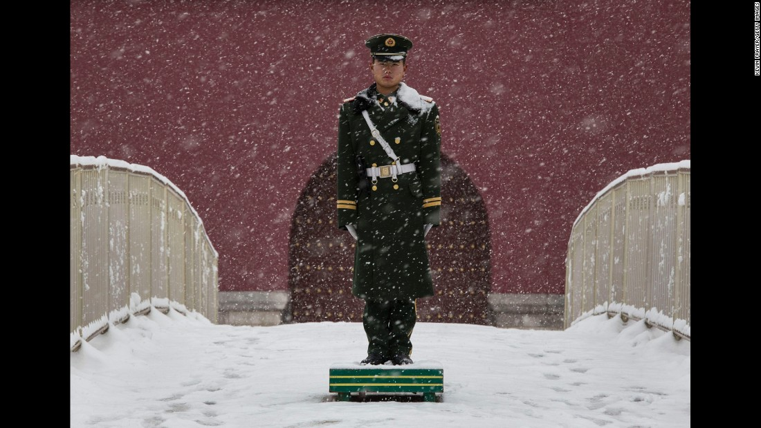 A Chinese paramilitary police officer stands guard outside Tiananmen Gate in Beijing.