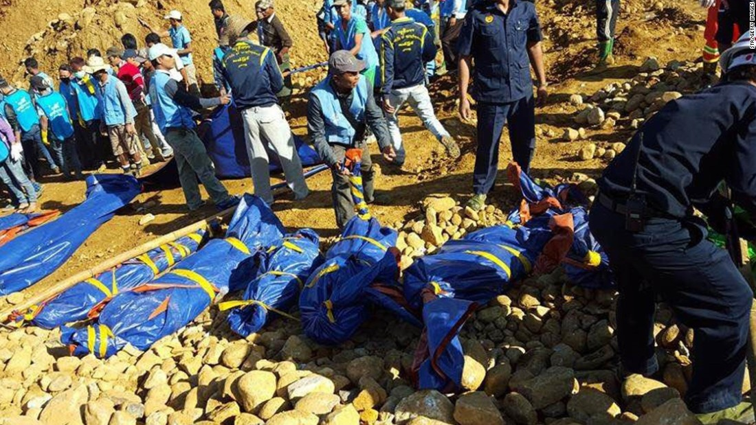 The bodies of miners killed by a landslide are placed on the ground in a jade mining site in Hpakhant in Myanmar's Kachin state.