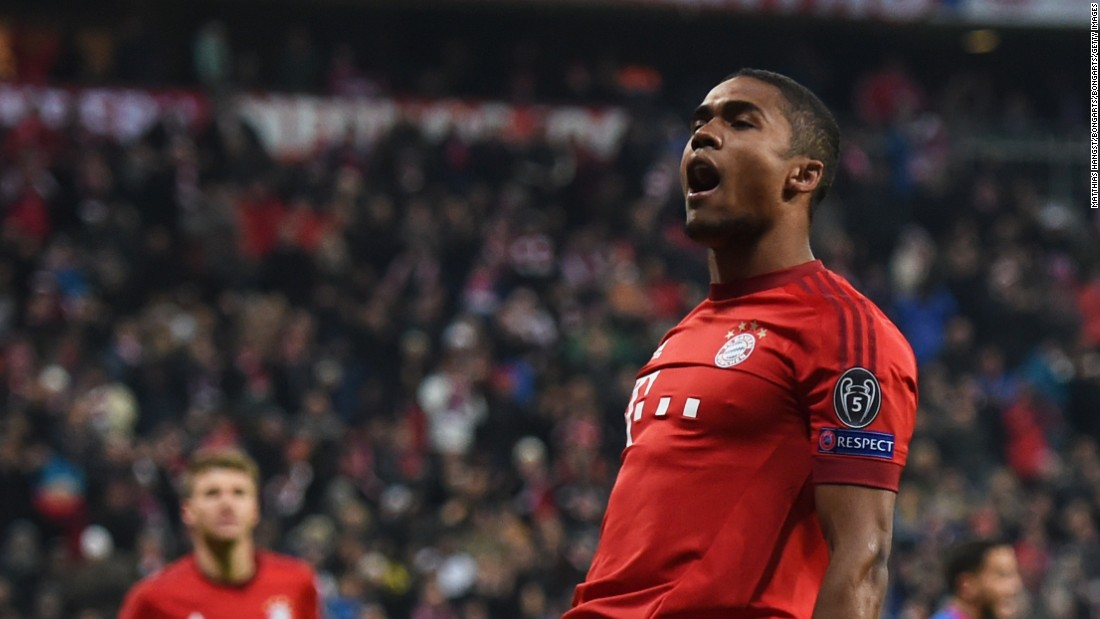 Douglas Costa of Bayern Munich scores his team' s opening goal against Olympiakos in the Allianz Arena.