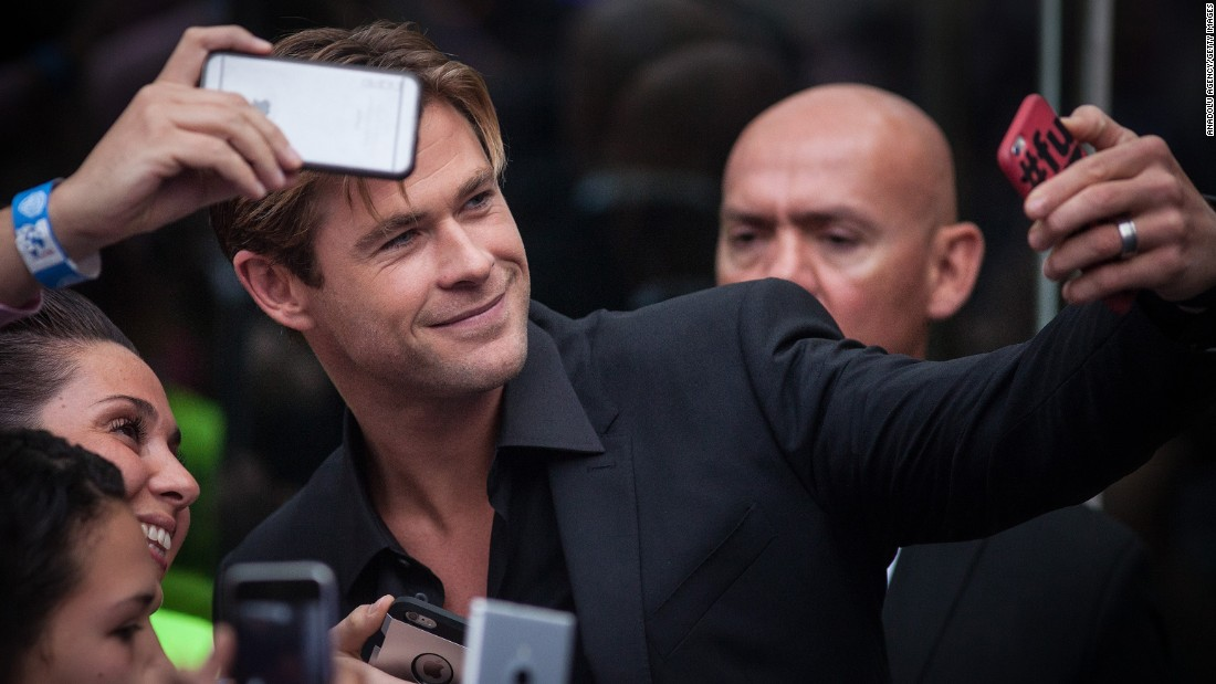 "Actor Chris Hemsworth takes a selfie with fans at the Mexico City premiere of ""In the Heart of the Sea"" on Monday, November 23."