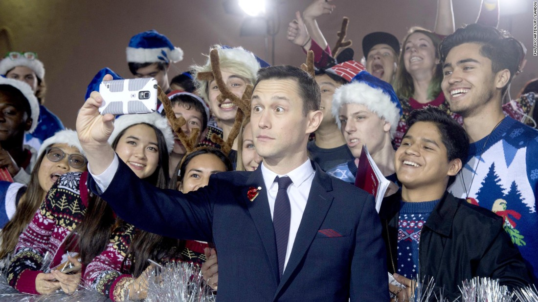 "Actor Joseph Gordon-Levitt snaps a selfie at the Los Angeles premiere of his new film ""The Night Before"" on Wednesday, November 18."
