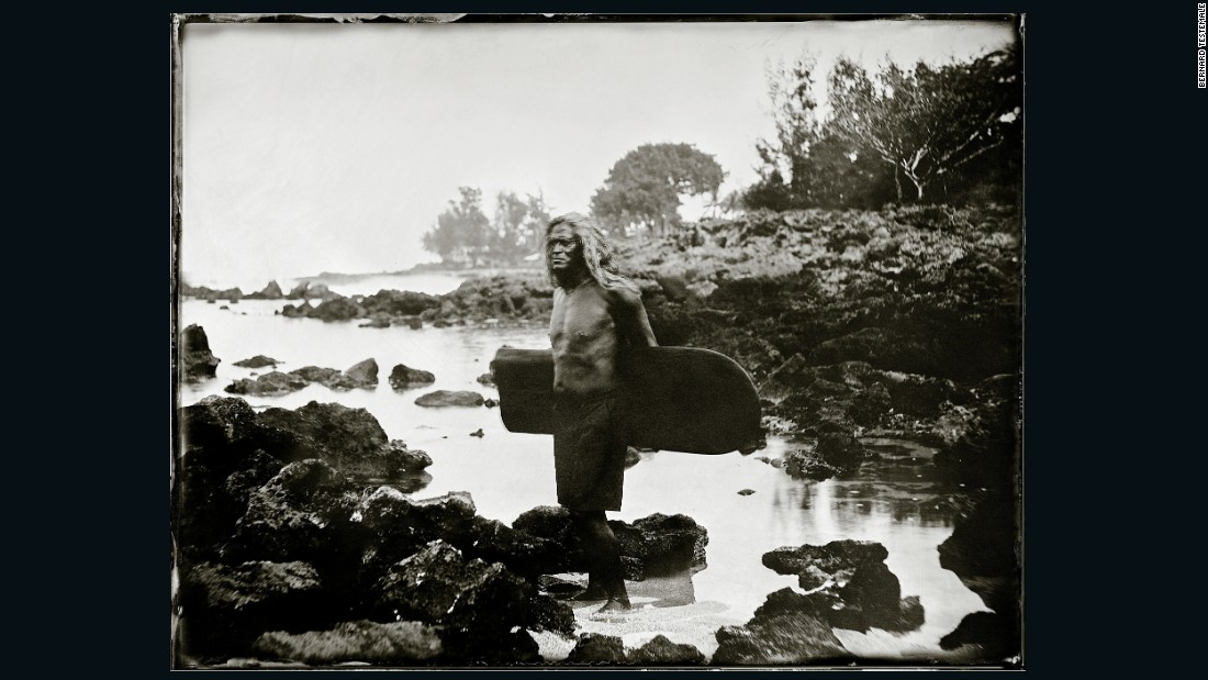"Testemale also recreated an iconic Hawaiian photo taken when Waikiki was still relatively undeveloped.<br />For his subject he chose Titus Nihi Kinimaka, a former big-wave competitor who regularly featured as an invitee in ""the Eddie.""<br />""One year he almost passed away, he dislocated his arm and he couldn't swim. They went in and saved him,"" the 57-year-old says.<br />""He's like a legend. And the way he looks with his long hair, face and native Hawaiian face, I wanted to use him for that photo. In his portrait he looks like an Indian chief, which is one of the major aims of this collection."""