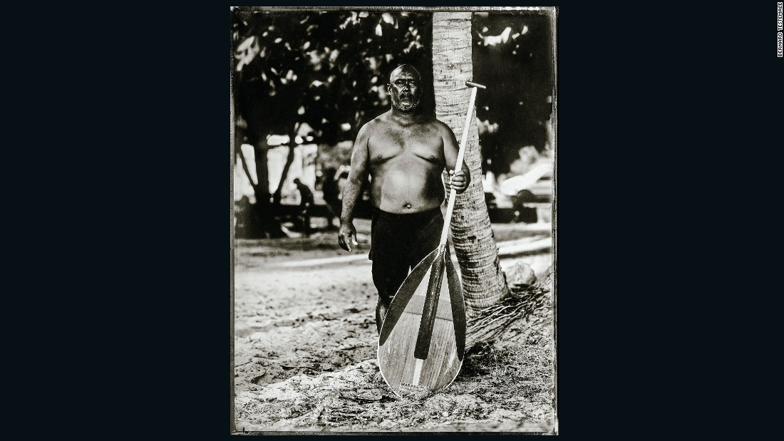 "Testemale says the wet-plate development process is ""quite fast -- you can see the photo coming to life in two or three minutes, like a polaroid."" Another thing in common with the instant format is the photographs' distinctive borders.<br />Here he pictured Hawaiian canoe racer and lifeguard Mel Puu.<br />""He brought this paddle to Paris, he left it here in my house. I'm going to use it everywhere I go,"" Testemale says."