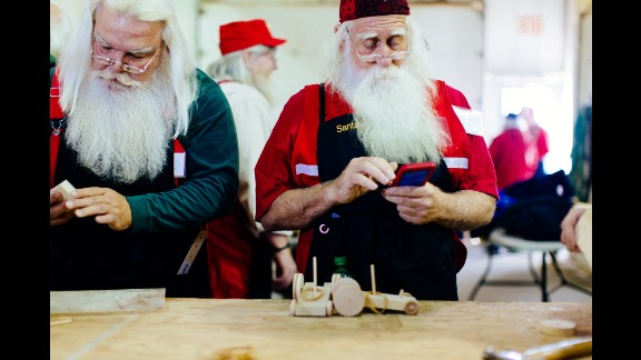 The Santas also learn how to make wooden toys at Valent's company, Gerace Construction. Children are going to ask how the toys are made, he says, so it's important for the Santas to have these experiences to draw from when they answer.