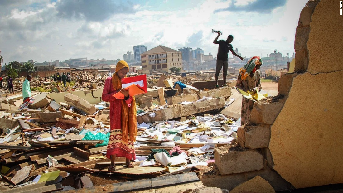 Abou Kisige was the overall winner, and also placed first in the news category for this image of a student from Nabagereka Primary School searching for her notes in the debris left behind after her school was bulldozed. The institution, named after the Queens of the Buganda Kingdom, was home to more than 600 pupils and 50 staff. The school was razed in the early hours of the morning to avoid opposition to the school being moved.